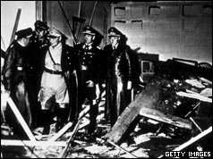 Hermann Goering (second from left) inspects the bomb damage at Rastenberg