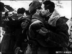 Russian soldiers hugs each other when a corridor is opened to Leningrad in January 1943