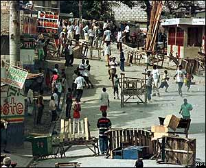 Demonstrators erecting barricades during 2000 election campaign in Port-au-Prince