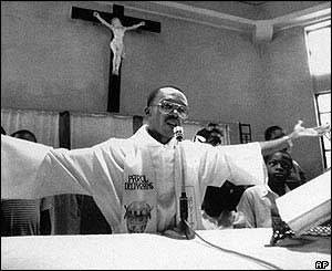 Aristide as priest in 1988