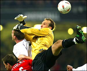 Mark Schwarzer challenges for the ball in the air