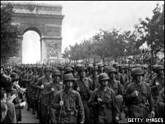 US troops march along the Champs Elysee