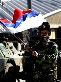 A Kosovo Serb waving the Serbian flag in Mitrovica