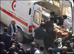 A man is loaded onto an ambulance following a series of blasts in Karbala