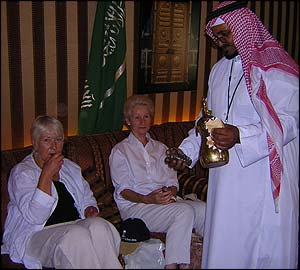 Sally Hanford (left) and Anne McIntyre are served tea in a traditional Bedouin tent