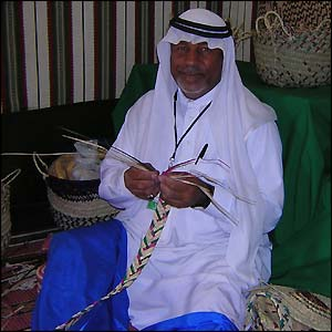 A Bedouin basket maker, who was one of many of the artisans at the event