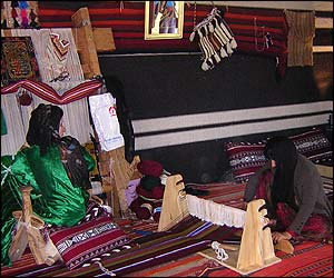Saudi artisans demonstrating rug making