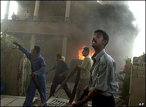 Iraqis fight a building fire