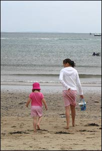 Rhiannon Griffin walking Elloise Curry to get water from the sea at Oxwich Bay, taken by Chris Curry.