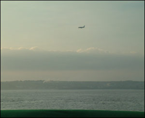 An aeroplane coming into land at Cardiff International Airport, taken from the Bristol Channel by Ioan Dyer, from Caerphilly