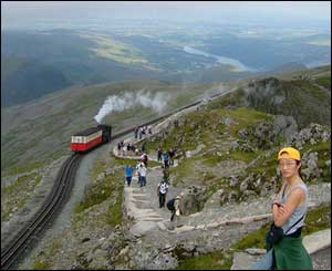 Aled Powell, living in Changwon, Korea, brought his Korean girlfriend Hyo-jung to Snowdon - she had not believed a train ran to the top