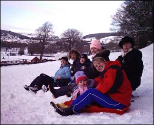 Nia, Osian, Morgan, Carys, Rhiannon, Mari and Geinor having fun on sledges (Dylan Lewis)
