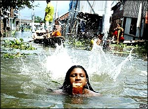 A girl swims through Bangladesh's flooded streets.