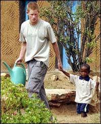 Mutsu Potsane shows Prince Harry around the Mantsase Childrens Home for orphans.