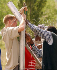 The fun-loving prince helps erect a fence.