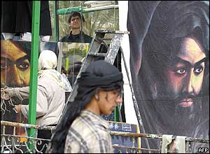 Giant posters of the Prophet Mohammed's grandson, Imam Hussein, are pasted in a Karbala square