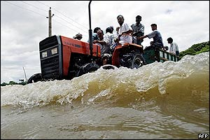 Bangladeshi villagers on a tractor along the flooded Brahmanbaria-Comilla highway
