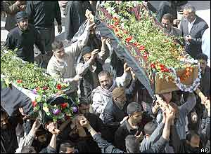 Greenery-draped coffins of two bomb victims in Karbala