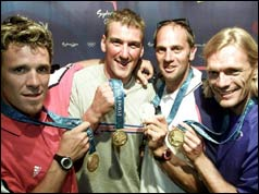 British rowers (left to right) James Cracknell, Matthew Pinsent, Steve Redgrave and Tim Foster hold the gold medals