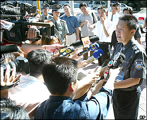 A police spokesman makes a statement outside the kindergarten, 4/8/04