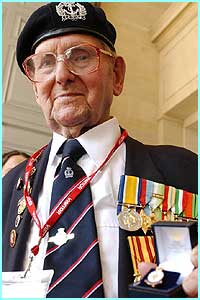 103-year-old William Stone from Oxfordshire, proudly displays his comemorative medal