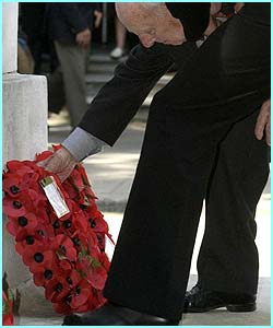 Henry Allingham lays a wreath at the service. The 108-year-old, the oldest of the war veterans, served with the Royal Naval Air Service during the war.
