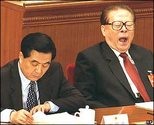 China's head of the Central Military Commission, Jiang Zemin (R) yawns next to President Hu Jintao