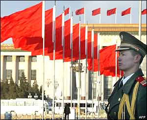 A Chinese paramilitary guard stands at attention on Tiananmen Square