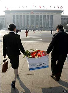 In Beijing, flowers were being distributed to female delegates at the National People's Congress at the Great Hall of the People.