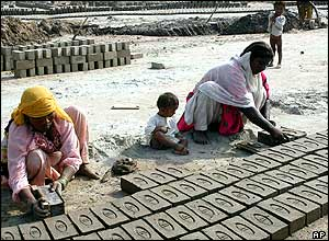 Women at this brick kiln in Multan, Pakistan, earn US$2 for 1,000 bricks