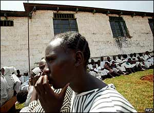 Women inmates sit outside their prison cells at the Langata womens prison in Nairobi.