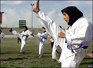 Afghan girls practice Tae Kwon Do at Kabul stadium.