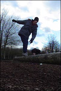 Ben balancing on the log at Cosmeston Lakes Country Park, as captured by John Parker from Cardiff