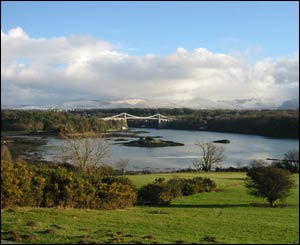 The Menai Strait and Menai Bridge, with snow on the mountains in the background (Andrew Woodvine)