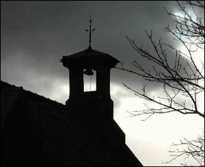 The church in Waunfawr against a gathering storm, captured by Peter Roberts of Bontnewydd