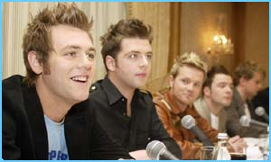 Bryan and his ex-bandmates at the press conference