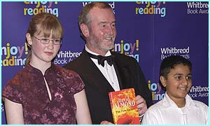 David Almond, whose book The Fire-Eaters won the 2003 Whitbread Children's Book Award, with young judges Jacquie and Niral