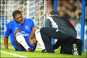 Chelsea's Glen Johnson receives treatment