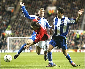 Ruud van Nistelrooy is sandwiched between two Porto defenders