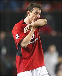 A dejected Gary Neville leaves the field