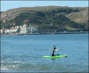 Canoes in Llandudno bay making the most of the sun, from Greg Robbins