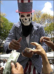 Venezuelan protester in a skull mask dressed as