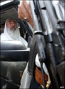 Yassin in front seat of jeep during anti-US demo in Gaza City