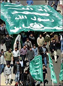 Hamas supporters carry green Islamic flags during the funeral procession