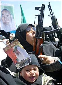 Palestinian woman and child take part in protests against Sheikh Yassin's killing