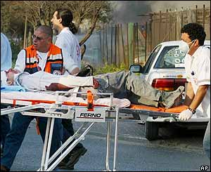 A wounded Israeli taken from the scene of a twin Hamas suicide bombing in Ashdod on 14 March 2004