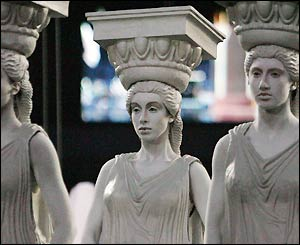 Young women dressed as classical Greek style pillars