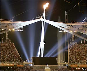 The Olympic flame burns brightly for all the stadium to see