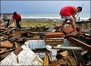 Cuban Mirta Estrada (left) and her son Yosel Fuente survey the damage in Baracoa, western Cuba