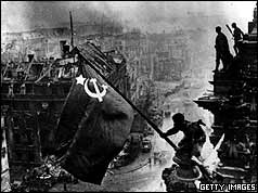 Red Army soldiers raise Red Flag over Reichstag, taken 30 April 1945